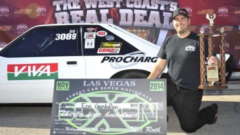 Eric Gustafson next to Race Car